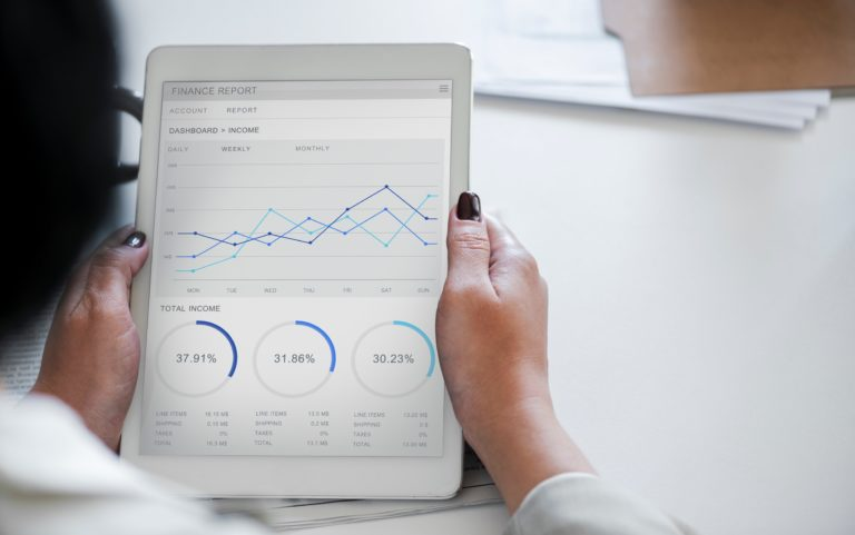Woman reading analytics in course