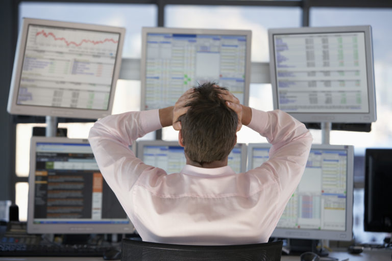 Man frustrated looking at analytics